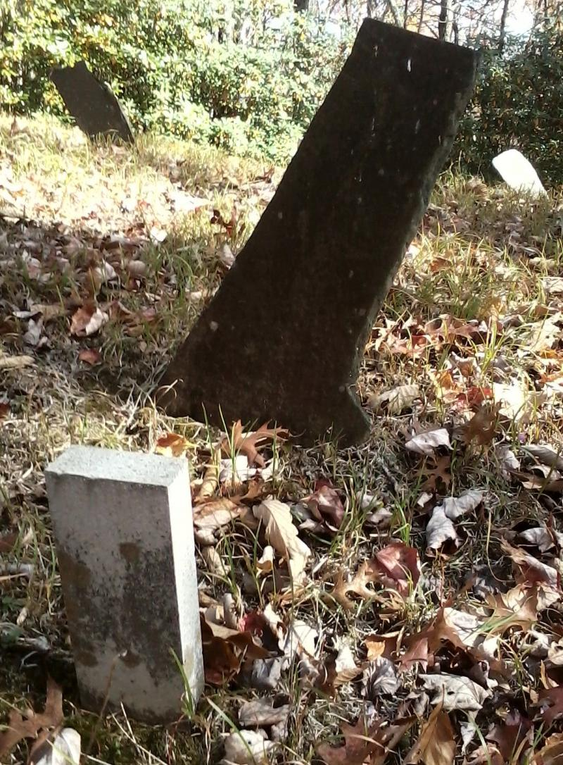 It was customary for a grave to have a main headstone and a smaller footstone.